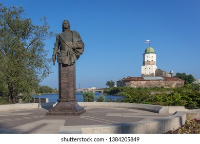 Vyborg, Russia - July, 2016: monument to Apraksin and ancient castle in background.