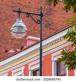 Vyborg, Russia, July 25, 2021. Fragment of a typical historical architectural ensemble. Beautiful lamp post