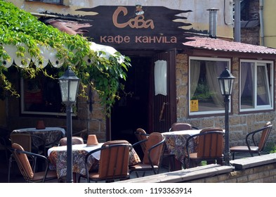 """VYBORG, RUSSIA - JUNE 30, 2013 - Cafe """"Sova"""" (""""Owl"""")  with summer terrace in Vyborg city, Russia"""
