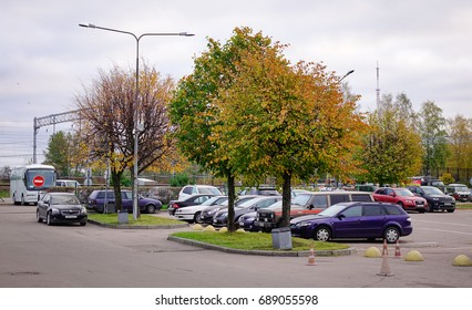 Vyborg, Russia - Oct 6, 2016. Cars parking at autumn garden at downtown in Vyborg, Russia. Vyborg is 174km northwest of St Petersburg and just 30km from the Finnish border.