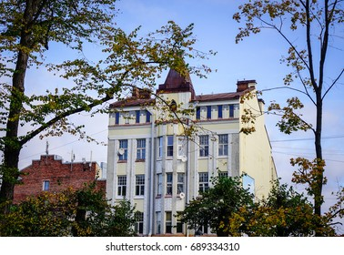 Vyborg, Russia - Oct 9, 2016. Old buildings with autumn trees at sunny day in Vyborg, Russia. Vyborg is 174km northwest of St Petersburg and just 30km from the Finnish border.