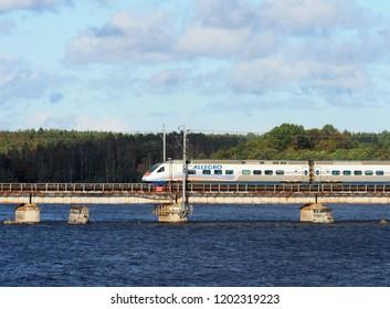 Vyborg, Russia - September, 2018. Allegro Train travels to Finland via the railway bridge, Vyborg gulf, Russia.