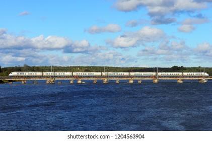 Vyborg, Russia - September, 2018. Allegro Train travels to Finland via the railway bridge, Vyborg gulf, Russia