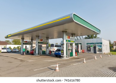 VYLOK, UKRAINE - SEPTEMBER 10, 2017: Unrecognized people refuel cars at OKKO gas station. Today OKKO network consists of 391 modern filling complexes, first station was opened in 1999.