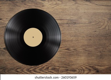 vynil record disc on wooden table