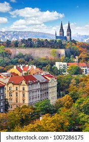 Vysehrad picturesque district in Prague, Czech Republic. Autumn landscape with vintage fortress, cathedral at knoll. Sky with clouds.