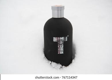 Vysoke Tatry, Slovakia, circa october 2016: Tatratea alcohol bottle in snow