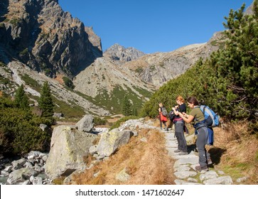 Vysoke Tatry, Slovakia - October 10, 2018: Hikers on trail at Valley of Five Spis Lakes. High Tatra Mountains, Slovakia.