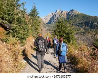 Vysoke Tatry, Slovakia - October 11, 2018: Hikers on trail at Valley of Five Spis Lakes. High Tatra Mountains, Slovakia.
