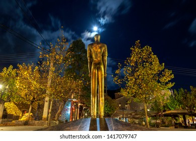 VYTINA/GREECE - November 4 2017: A bronze statue standing in the main public square of Vytina village, in Peloponnese, Greece, in a full moon night. - Shutterstock ID 1417079747