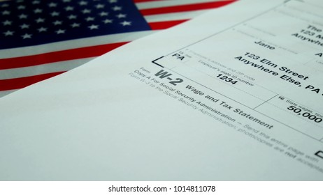 W-2 2017 tax form Copy A for woman person Jane Doe turns with american usa flag. Wage and tax statement