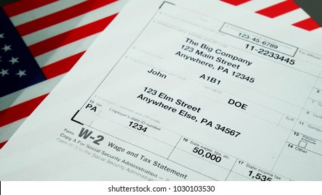W2 tax form Copy A 2017 for man person John Doe turns with american usa flag. Wage and tax statement