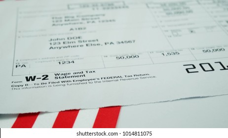 W2 tax form Copy B 2017 for man person John Doe turns with american usa flag. Wage and tax statement