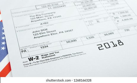 W-2 Tax Form and statement. Filling tax information concept