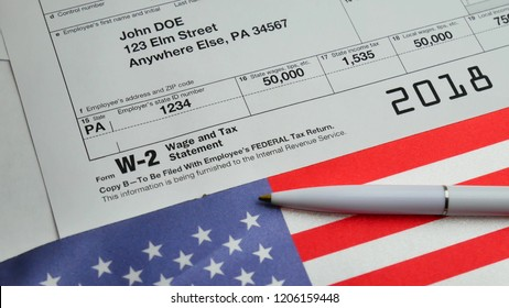 W-2 Taxes Form 2018 for man person John Doe turns with american usa flag and pen. Wage and tax statement concept
