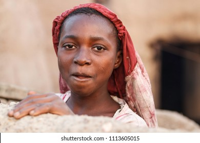 Wa, Ghana - December 28, 2011: Portrait of a young woman from the Lobi tribe in a small village near Wa in the North West of iGhana