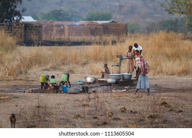 Wa, Ghana - December 28, 2011: People from the Lobi tribe at a water pump in a small village near Wa in the North West of Ghana