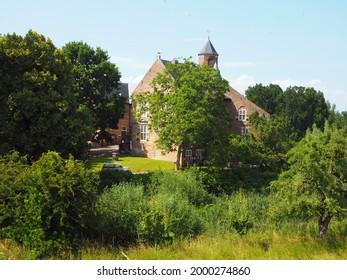 Waardenburg, Netherlands - june, 27, 2021: Castle waardenburg in West Betuwe, Netherlands. This medieval castle is build in 1265,