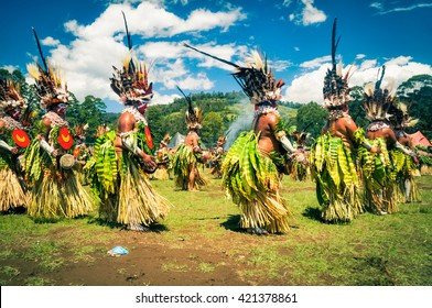 Wabag, Papua New Guinea - August 2015: Native women dance in circle during traditional Enga cultural show in Wabag, capital of Enga Province, Papua New Guinea. Documentary editorial.
