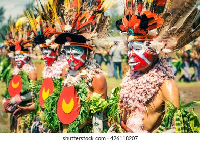 Wabag, Papua New Guinea - circa August 2015: Beautiful native women dressed in costumes with colourful faces at traditional Enga cultural show in Wabag, Papua New Guinea. Documentary editorial.