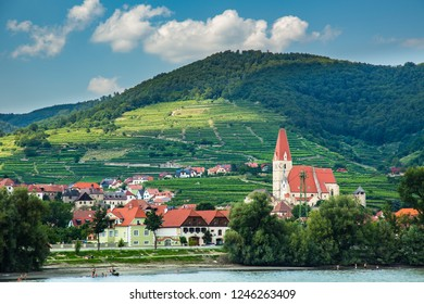 Wachau Valley, Austria - 7/10/2013:  A Christian Church with a clock tower in the Wachau Valley wine region along the Danube River, Austria