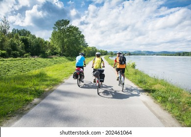 WACHAU VALLEY,AUSTRIA-MAY 9,2014:People are riding bicycle at cycle path near danube river in Austria during a sunny day