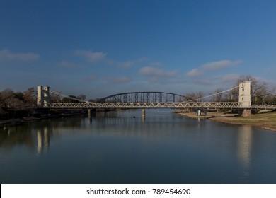 Waco Suspension Bridge in foreground and Washington Ave Bridge in background