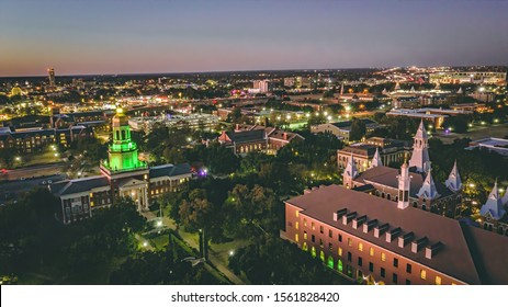Waco, Texas - November 15, 2019:  Baylor University's Pat Neff Hall lights up green in front of the Silos, the Alico Building, and McLane Stadium before Baylor football takes on the Oklahoma Sooners