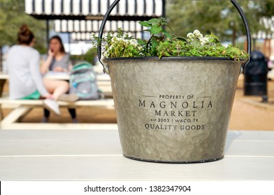 WACO, Texas / United States - April 1, 2019, Closeup of planter with flowers at Magnolia Market owned by Chip and Joanna Gaines from the HGTV show Fixer Upper