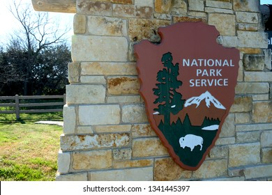 Waco, Texas, USA; March 13 2019; Sign and logo for the National Park Service located at the entrance to the Waco Mammoth National Monument.