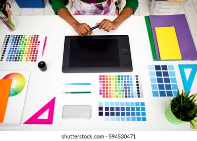 Wacom tablet, palettes and other design tools on workplace
