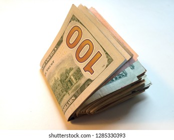 A wad of American cash with a 100-dollar bill on the outside