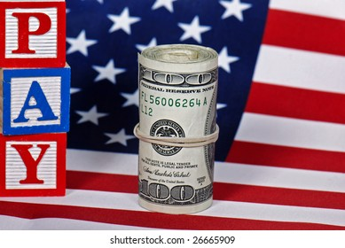 wad of cash and blocks on flag
