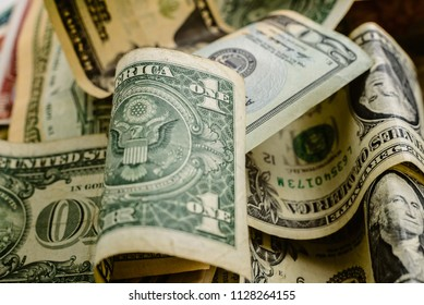 wad of dollar bills on a table