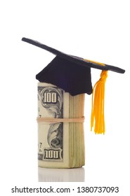 A wad of hundred dollar bills wrapped around themself with a mortarboard ontop depicting the high cost of Education or the College Admission Bribery Scandal.