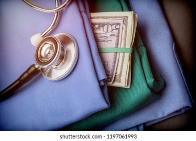 Wad of money American dollar in nursing clothes, stethoscope on nursing clothes