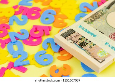 """Wad of 10000‐yen notes and numbers. Translation : """"Bank of Japan Tickets"""" """"One hundred thousand yen"""" """"The Bank of Japan"""" by Koji Yamamoto"""