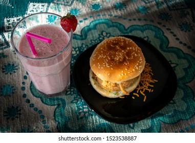 Wada pao and strawberry milkshake , traditional maharastrian pao