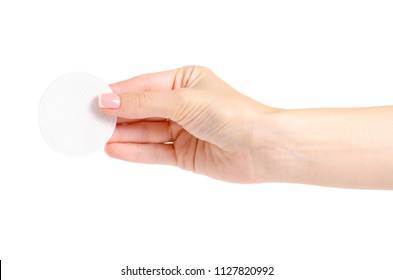 Wadded cotton pads in a hand on a white background isolation