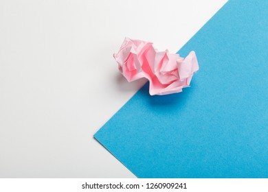 Wadded paper balls on a blue background