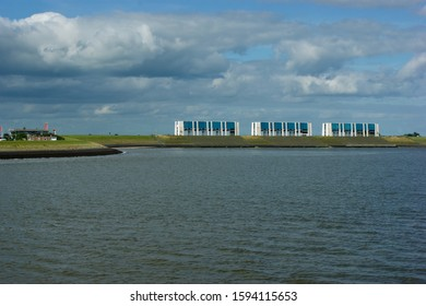 Wadden Sea, The Netherlands - july 13 2017: View of the R.J. Cleveringsluizen complex from the Wadden Sea