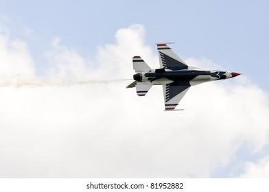 WADDINGTON, ENGLAND, UK - JULY 3: USAF  Thunderbird 5 Major Aaron Jelinek during a high speed pass at Waddington International Air Show on July 3, 2011 in Waddington, England, UK.