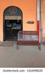WADDUWA, SRI LANKA - JANUARY 16, 2019: platform entrance to a station office with a seat under a sign saying reserved for clergy.