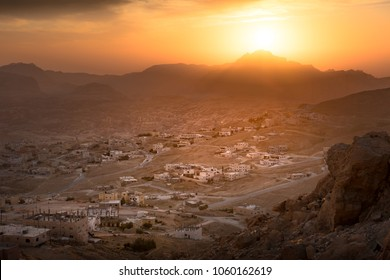 Wadi Musa, city of Petra in Jordan. Beautiful sunset over Wadi Musa, town located in Ma'an Governorate in southern Jordan. It is the administrative center of the archaeological site of Petra.
