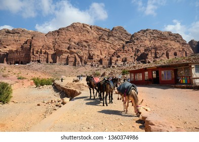 WADI MUSA, JORDAN - MARCH 06: Unidentified tourists and horses in the UNESCO World Heritage site of Petra, preferred travel destination in Middle East, March 06, 2019, Wadi Musa, Jordan
