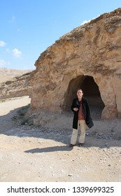 Wadi Qelt, Israel: 4/13/2015 - Saint George Koziba monastery, Judean desert, near Jericho,  surroundings, landscape and nature in desert oasis canyon with people in different situation