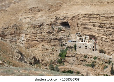 Wadi Qelt in Judean desert near Jericho, Israel. Nature, stone, rock, canyon and oasis. Unseen, unknown, unexplored places, hidden travel destination. Panoramic view and landscape