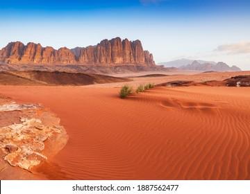 Wadi Rum Desert, Jordan. The red desert and Jabal Al Qattar mountain.