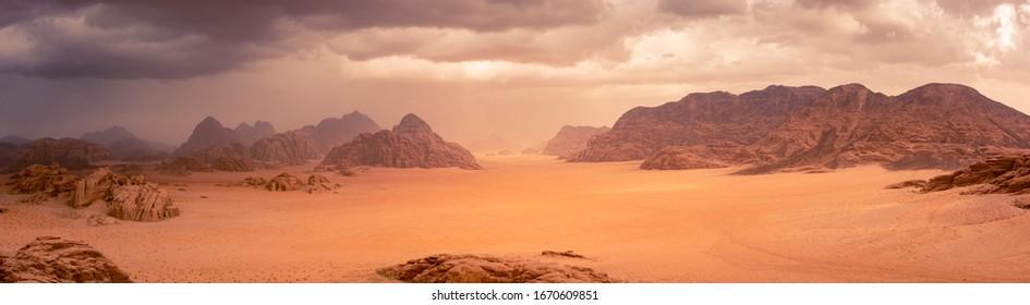 Wadi Rum desert in Jordan under dramtic rain and storm clouds. Panorama picture.