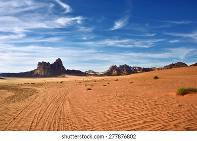 Wadi Rum desert landscape at sunset time, Jordan. View on the cliff called Seven Pillars of Wisdom which described in book of the British officer Lawrence of Arabia